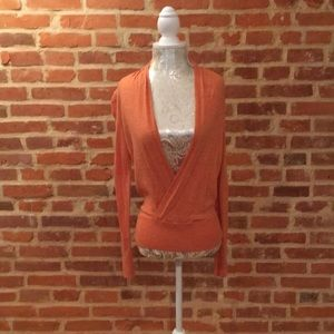 The limited faux v-neck wrap long sleeve top.
